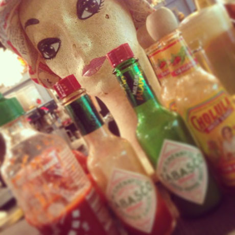 closeup of hot sauce bottles